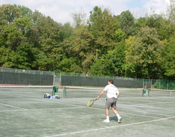 Playing tennis on har-tru courts at Idle Hour Tennis Club