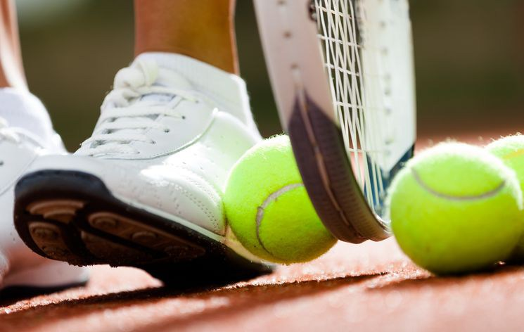 Tennis pro-shop provides tennis equipment, stringing, and ball machine